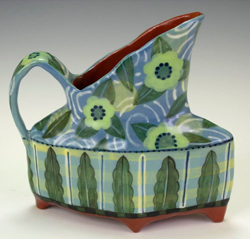 nancy and burt - diamond shaped pitcher with four feet in blue and green