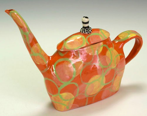 nancy and burt - orange teapot with floating circles