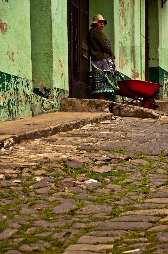 john shepherd - woman with a red wheelbarrow - Quetzeltenango.